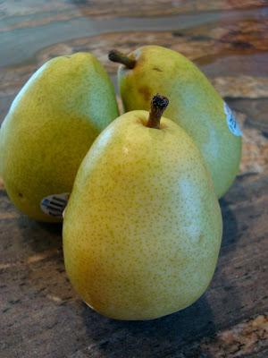 Three Bartlett pears on countertop