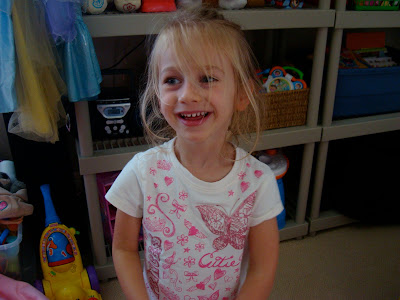 Young girl standing and smiling