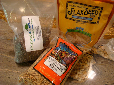Chia Seeds, Flaxseeds and Sunflower Seeds on countertop