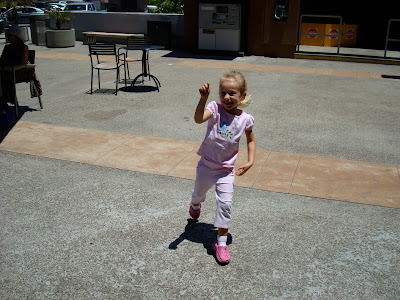 Young girl outside pointing