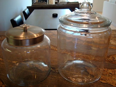 Two different sized glass canisters on countertop
