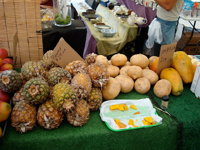 Pineapple, mangos and papaya on table