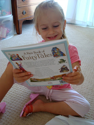 Young girl looking at A Book of Fairy Tales