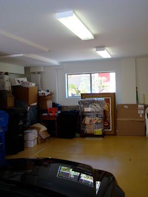 Widow view in garage full of storage items
