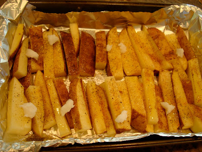 Coconut & Olive Oil Roasted Potato Sticks on foil lined baking pan