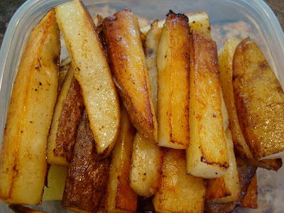 Finished Coconut & Olive Oil Roasted Potato Sticks stacked in container