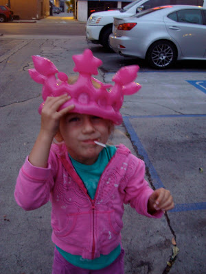Young girl wearing a blow up pink crown