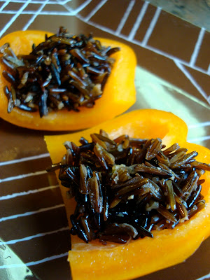 Cooked Wile Rice in sliced orange peppers