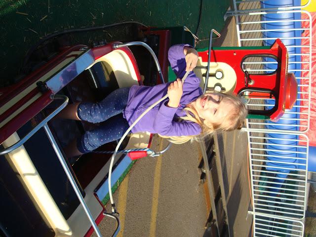 Young girl riding mini train