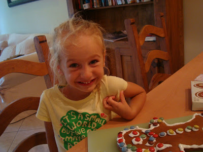 Young girl sitting at table smiling