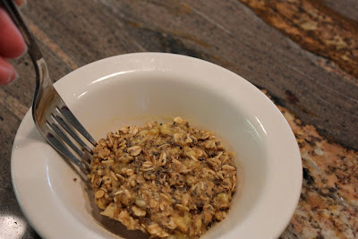 Microwave Banana Oat Cakes in white bowl with fork
