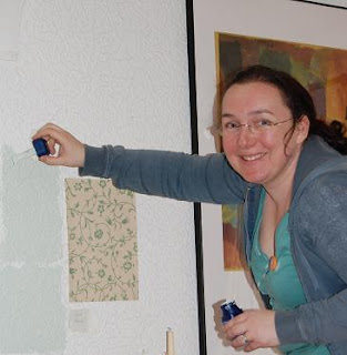 Steph painting a wall