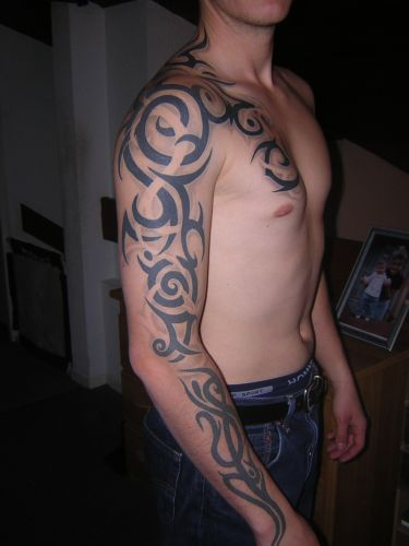 Tribal Arm And Shoulder Tattoo