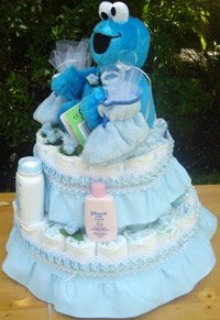 Details On The Cookie Monster Diaper Cake Are: One Pair Of Booties 58 1  Size Diapers. One Plush Cookie Monster Baby Powder Size(1.5oz) Shampoo  (1.5oz)