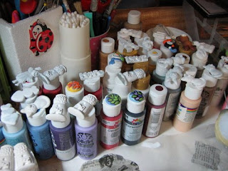 bottles of paint in my workspace