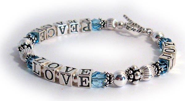 This PEACE LOVE JOY bracelet is made with Swarovski crystals (you choose the