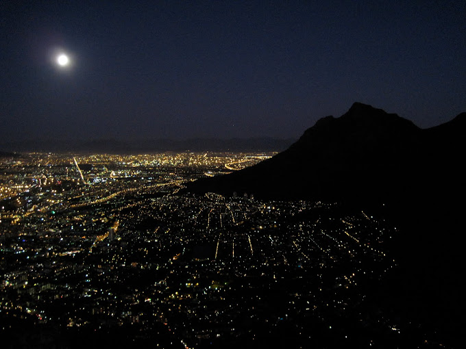 Cape Town at night with the full moon. Devil's peak on the right