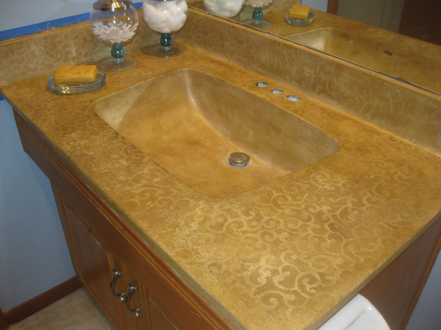 Cultured Marble Vanity 1. This vanity is complete with a chip.