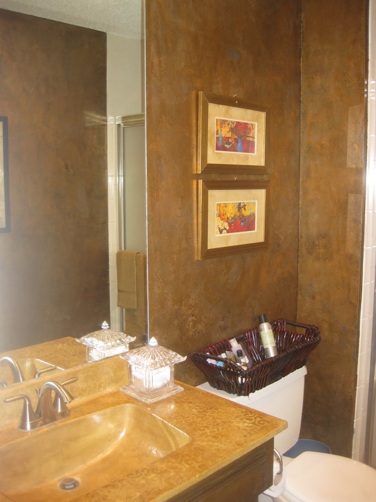 Small Bathroom Brown Walls with Pictures