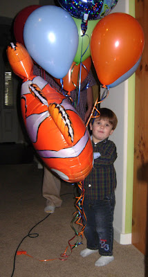 boy and birtday balloons