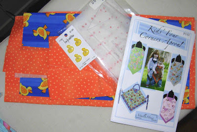 apron fabrics all cut out and ready to go