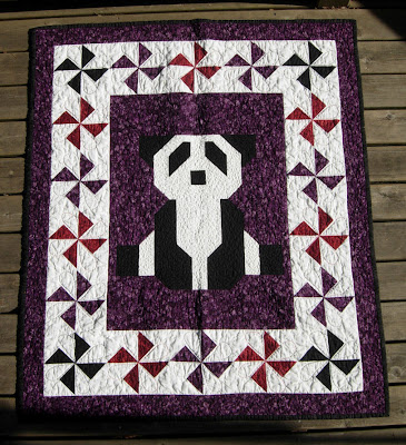 completed Purple Patchwork Panda quilt