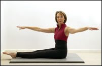 Woman performing Pilate Spine Twist, Fitness and losing back fat, losing bulging back to look fab ant gorgeous