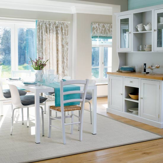 This country style kitchen is offset beautifully by turquoise accents