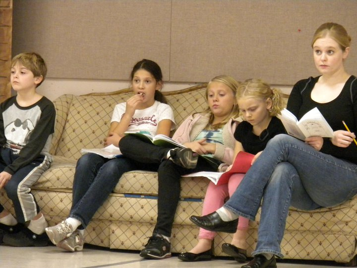 Ruth Arnell�the show�s Mary Hatch with four kids in rehearsal