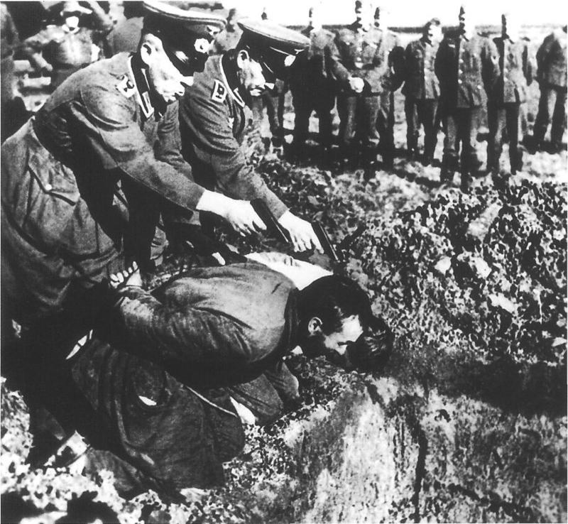 Gruesome photo of the gestapo officers shooting a russian peasant