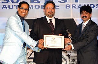 Professor Arindam Chaudhuri (left) and Mr. Adarsh Hedge (right) giving away the award to Mr. Kaushik Roy, President- Brand Strategy & Mktg. Comm. , Reliance Industries (center)