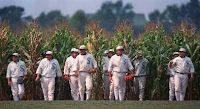 The field of dreams baseball players appearing out of the magic corn field walking on to the magic baseball field