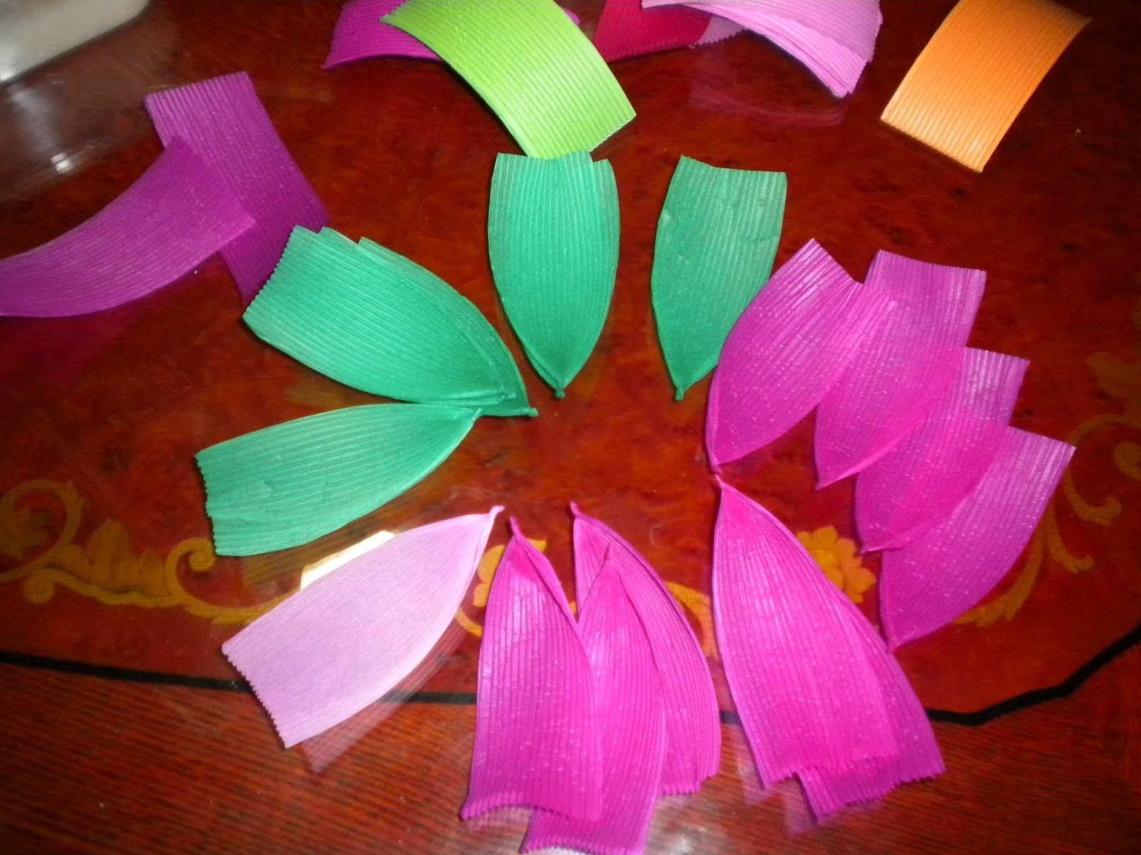 Buddhist temple stories lotus flower lantern making one end of each paper lotus petal twist with some glue into a tip mightylinksfo