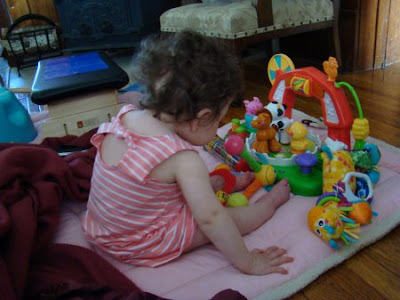 baby with toys photo