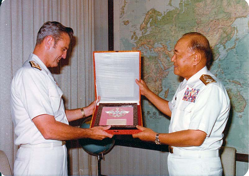 RADM Linder receiving award