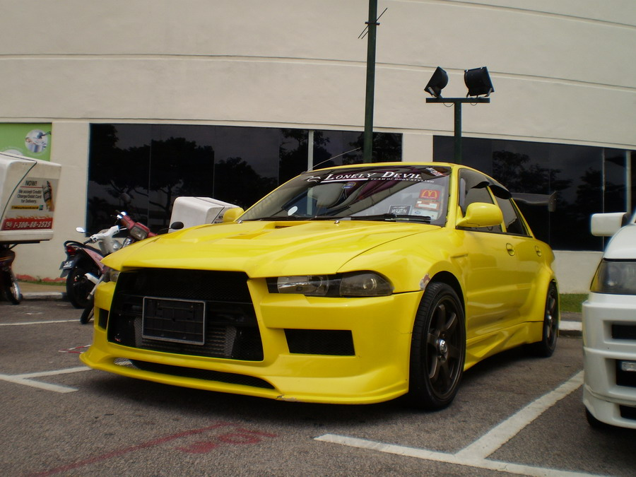 Proton wira with evo x body kit owned by member of team lonely devil