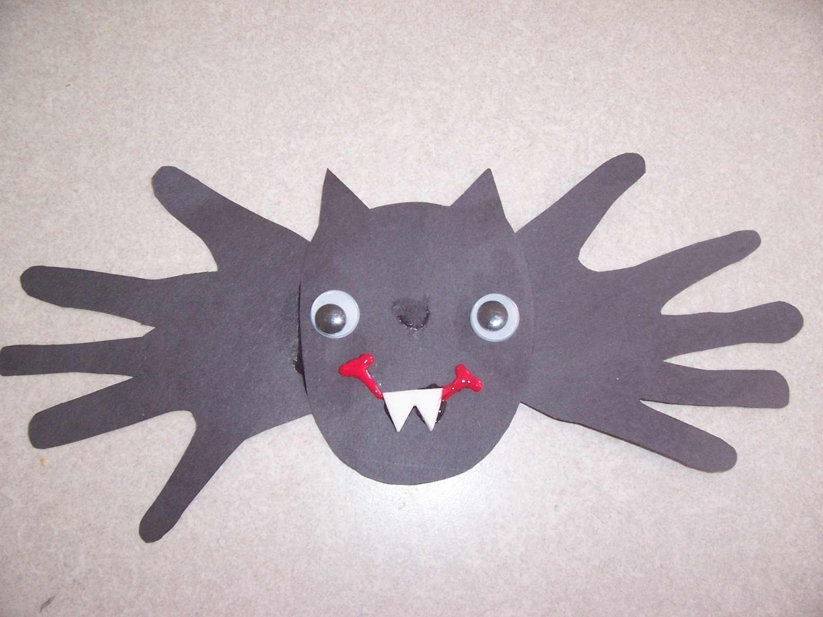 Because i said so and other mommyisms hand print bat craft for Crafts with hands