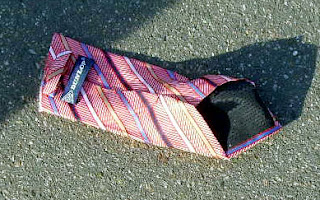 Exhibit A: Half a tie seen on pavement