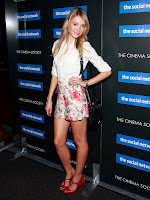 Katrina Bowden pink shorts white top