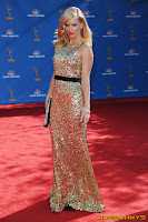 Heather Morris in a long gold dress