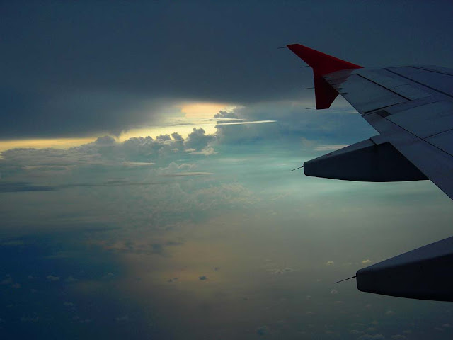 AirAsia wing and clouds over Sumatra