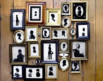 black and white color dominate the room and if i am the owner of the house i will have one side of the wall covered with these vintage frames