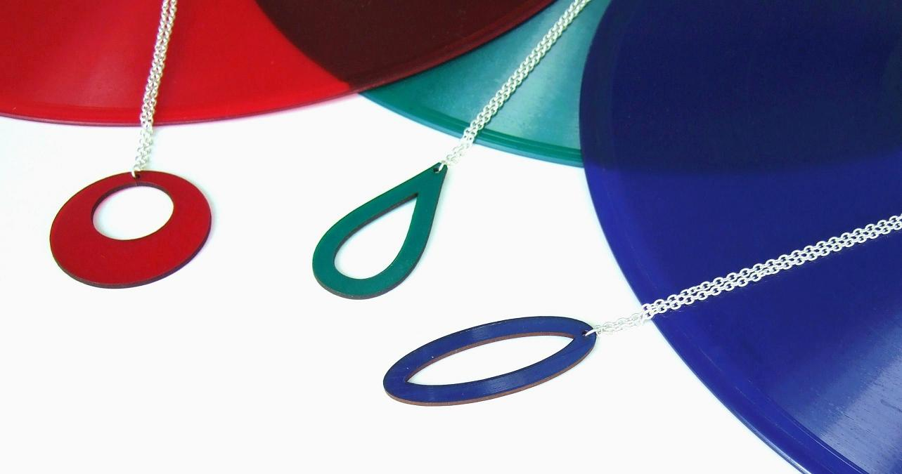 Aroha Silhouettes jewellery made from recycled vinyl records - fire engine red Contour necklace - emerald green Vapour necklace - sapphire blue Parabola necklace - made from bright and vibrant coloured vinyl records