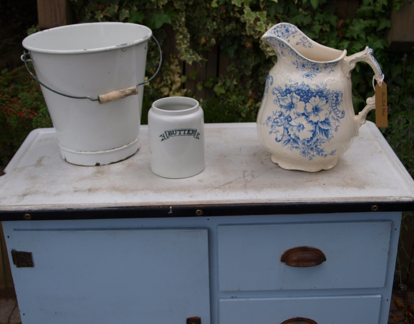 This small kitchen dresser base with battered enamel top would be a