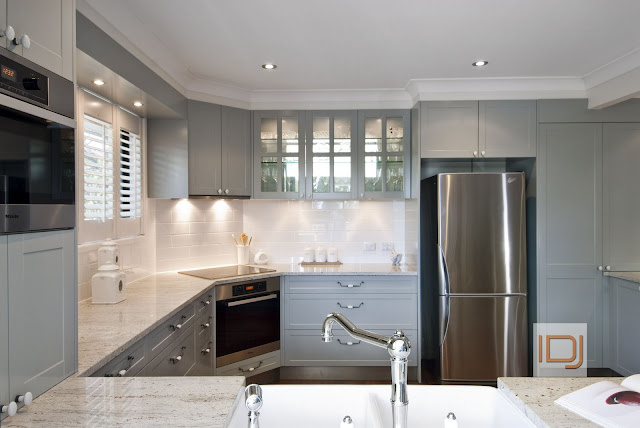 Grey Kitchen Cabintry, Limoge drawer pulls and Miele Appliances via @natashainozblog