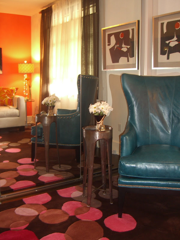 : traditional wing chair upholstered in a muted turquoise leather title=