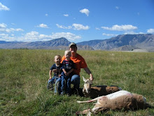 Lori and the boys with her two antelope