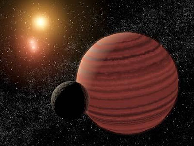 A Brown dwarf with a Straw moon clinging to its arse