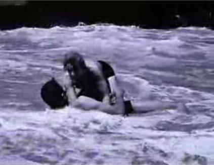 Neil and Deborah Kerr enjoy a little rough and tumble