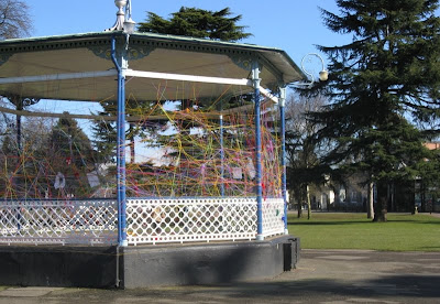 Leamington bandstand with colourful string strung between the posts